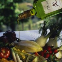 Laudemio Extra Virgin Olive Oil drizzled over vegetables.