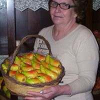 Maria Grammatico holding marzipan shaped and decorated like prickly pears.