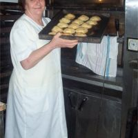 Maria Grammatico pulling pastries from the oven.