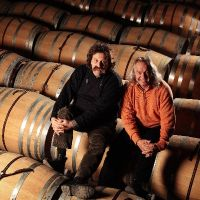 Pojer and Sandri in the barrel room.